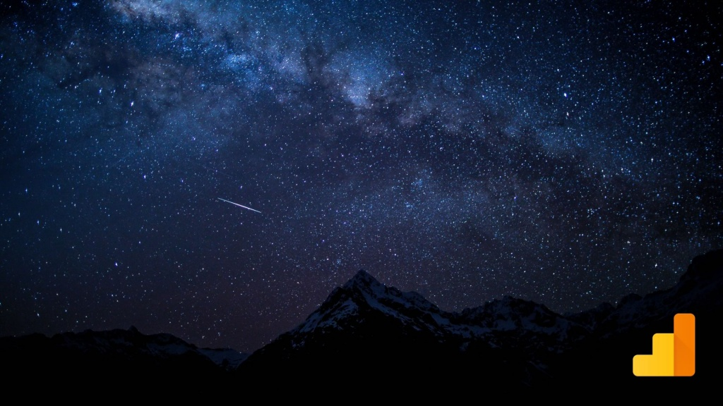 Shooting star over mountains with Google Analytics logo